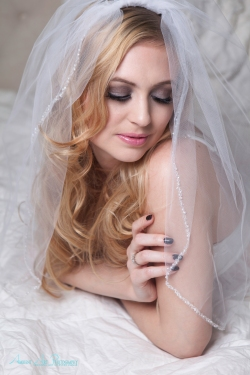 blond hair, smokey eyes, wedding veil